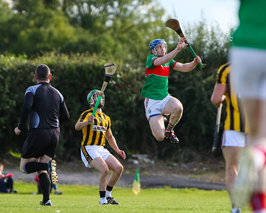 Loughmore Castleiney's Liam Treacy jumps highest, watched by Upperchurch Drombanes Colm Ryan