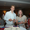 Mick Groll and Corinne Thule grab a bite at the Lutherans Concerned/North America Mix and Mingle.