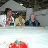 "Annie Allen, Lila Ellison, and Alda Rydin arrange the ""holey cloth."""