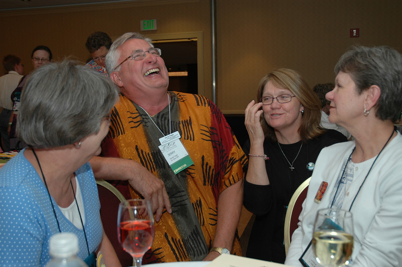 Connie Teigen, Jerry Vagts, Carol McCall, and Wendy Piano share a laugh at the Lutherans Concerned/North America Mix and Mingle.