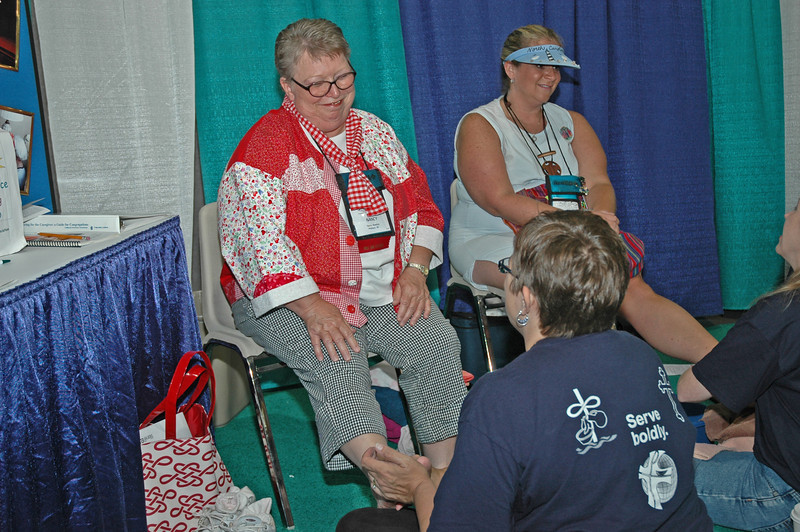 Nancy Wanless and Melissa Jernigan have their feet washed by deaconesses.