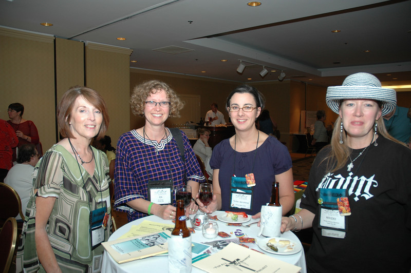 Pia Carlsen, Meridee Erickson-Stowman, The Rev. Beth Birkholz, and Deb Bakke share a drink at the Lutherans Concerned/North America Mix and Mingle.