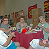 Janice Sieler, Valerie Saylor, Geraldine Sturm, Ellen Roof, and Mary Howe have fun in the Knitting Cottage.