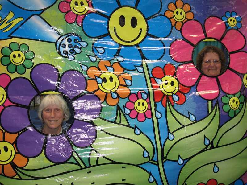 "Terri Ballenger and friend get their picture taken at the EOCM ""Growin' Groovy Congregations"" booth."