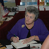 Sister Joan Chittister sits for a book-signing in the Augsburg Fortress Bookstore.