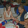 """Betty Christiansen, author of """"Knitting for Peace,"""" gets the Rev. Lynell Aljoe-Thurman started on a hat."""