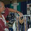 Vender Stan Booker arranges his merchandise.