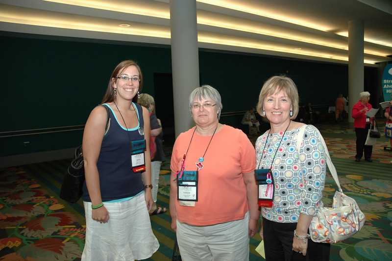 Delegate Teresa Burbudge(center) poses with two first-time attendees, Sarah Fischer (left) and Terri Pederson (right).