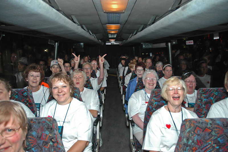 Happy runners on the bus.