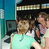 Participants check out the photos of the event at the email stations.