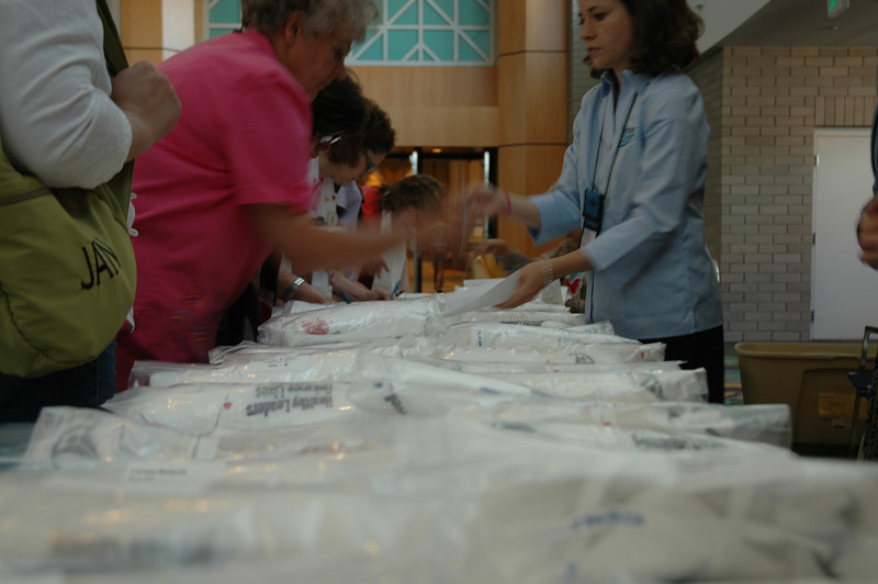 Staff member Emily Hansen helps participants register for the Run, Walk, 'n' Roll.