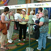 Delegates register at the triennial gathering
