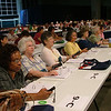 Delegates voting during convention business