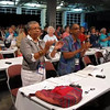 Delegates to the Women of the ELCA Seventh Triennial Convention take a break during a business session July 9 to stretch and sing. More than 380 delegates are meeting in Salt Lake City, Utah, to elect new officers, pass a budget, and respond to memorials and resolutions.  The business session precedes a three-day worship experience, Come to the Waters, where more than 2,000 will attend workshops, hear inspirational speakers, study the Bible, and shop in an exhibit area.