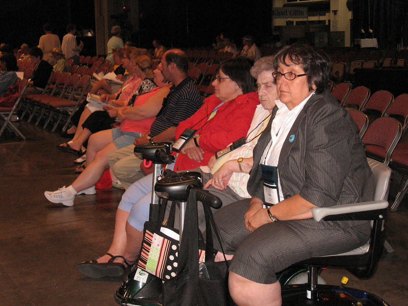 Folks in the audience pay close attention to the executive board voting (TLB)