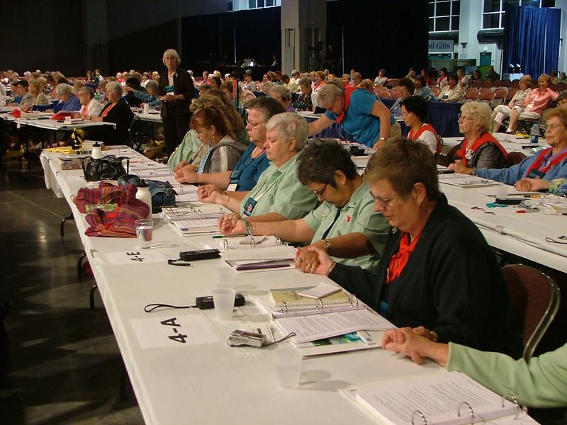 Delegates praying