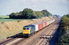 13th Oct 81:  Trotting down the Relief at Milley Bridge  is 47515 with a short liner composed mainly of Ford branded boxes
