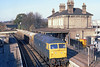 13th Nov 81:  Crawling through Chertsey is 47234  and a rake of empty Procar hoppers