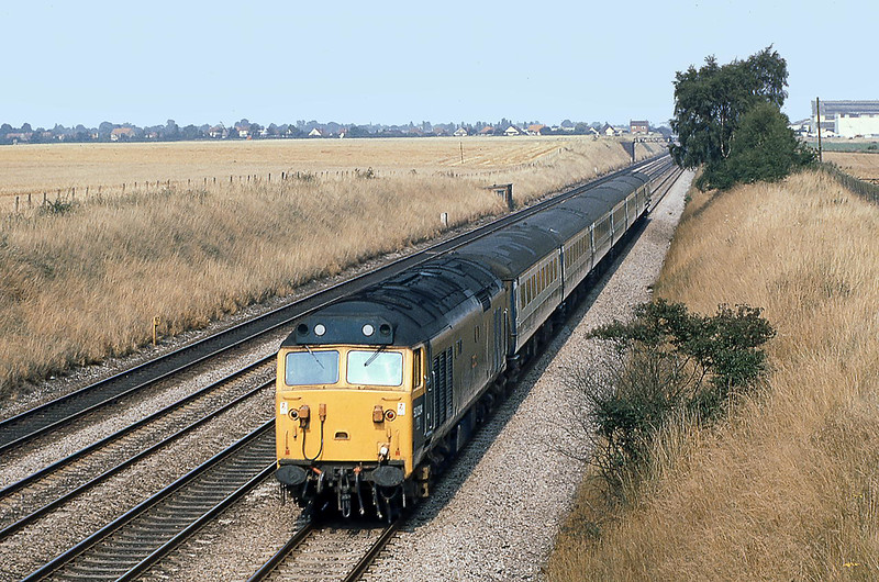 12th Aug 1981:  70024 'Vanguard' at an almost  treeless Shottesbrooke working the 15.50 to Birmingham