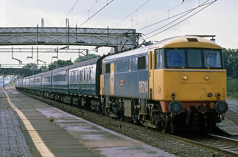 10th Aug 1981:  86214 'Sanspariel' racing to the north through Cheddington