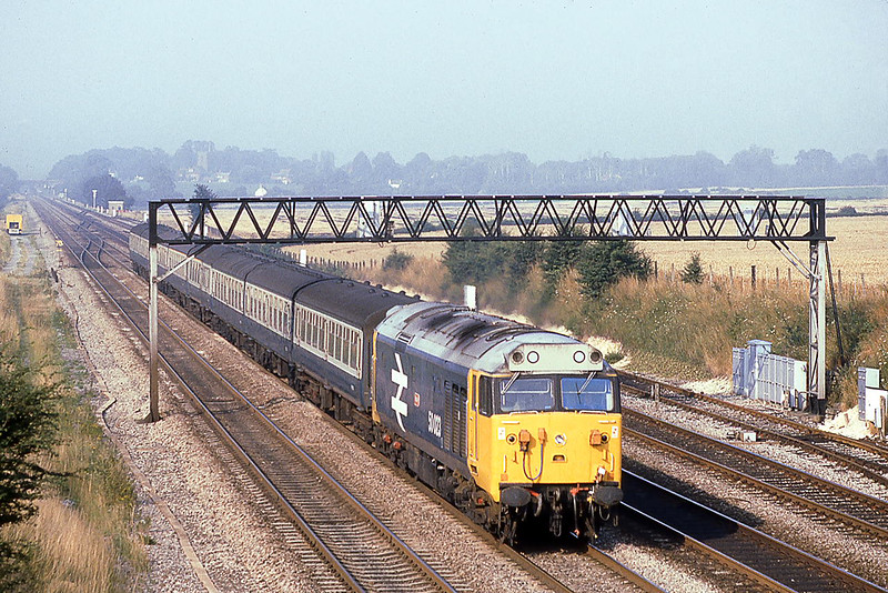 12th Aug 1981:  The 7am from Worcester with 50023 Howe on the point is seen from Milley Bridge in Waltham St Lawrence.  The 'Ladder' crossover at Ruscombe is seen behing the coaches