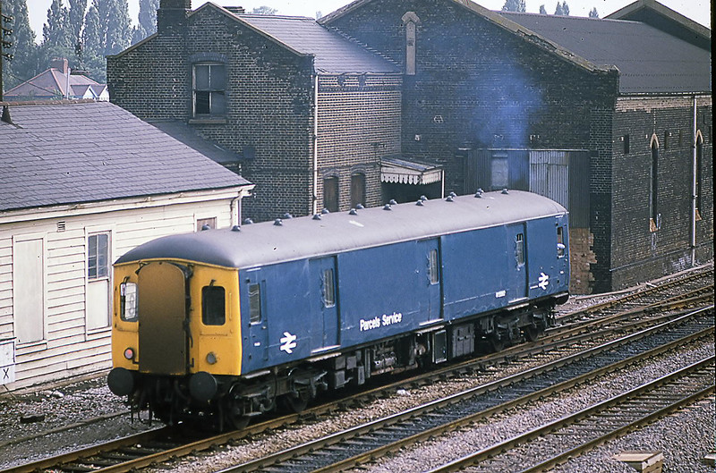 28th July 1981:  BCW Parcels van W55992 on the Up Slow passing the old Goods Shed at Southall
