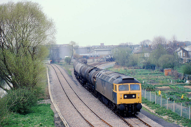 6th Apr 81:  47265 shunts oil tanks at Staines West.  With the GWR branch forn West Drayton burrried under the M25 a new connection was provided from the LSWR line to Windsor.  Seen her on the left