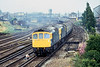 11th Jul 81:  In drizzle 33063+33046 run through Chichester with the 09.20 Brighton to Exeter
