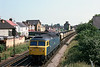 22nd Jun 81:  47055 trundles through Egham with empty hoppers.  New buildings have totally changed this view unfortunately