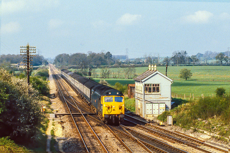 18th Apr 1981:  Taking the 'New Line' AKA 'Avoider' at Fairwood Junction is  50001 'Dreadnaught' on the 07.57 from Paignton to Paddington.  As the Name Plate has been rmoved from the signal box and the colour light signals are in place,  also he single slip has been removed I am sure that the box is just waiting to be dismantled.