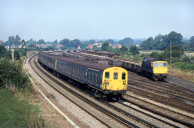 5th Sep 1981:  While 33037 shunts in the sidings 2 HAP 6062 is captured on the 09.32 fromPortssmouth to Brighton