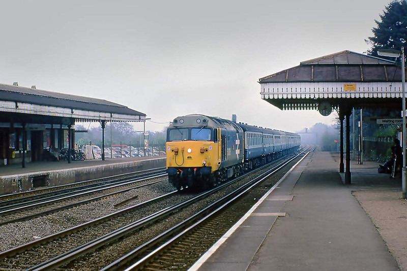 7th Apr 81: On not a very bright day 50038 'Formidable' hurries through Brookwood with the 11.05 Waterloo to Exeter