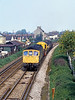 13th May 81:  Pottering through Egham with a Breakdown Train is 33018.  The tracks are the only bit of this view that remains the same which is a shame.
