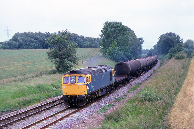 1st Jul 81:  Climbing through Silchester is 33030 with a rake of bogie oil tanks