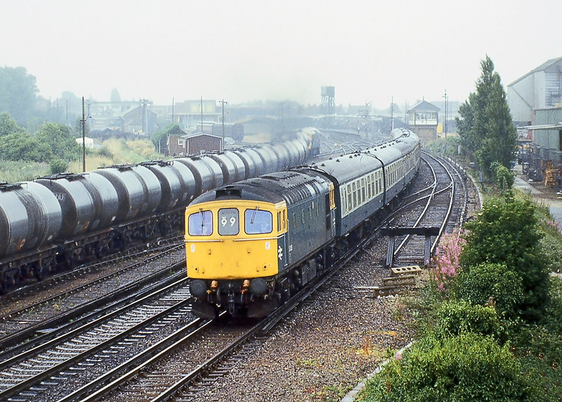 11th Jul 81:   At Chichester 33038 braves heavy drizzle as it passes on the 09.20 from Brighton to Cardiff