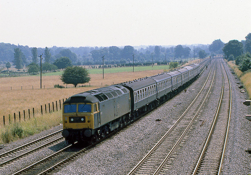 29th Jul 81:  The 12.50 Paddington to Worcester in the hands  of 47107 passing the now tree covered fields at Lower Basildon
