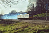 28th Feb 1981:  L414 forming the 15.22 Reading to Paddington is exiting the Sonning Cutting but is not looking very happy