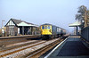 5th Nov 81:  73114 races through Byfleet & New Haw station with a load of 4 Mk 1 coaches as ECS from Clapham to Eastleigh