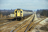3rd Feb 81:  Headed by 4TC 403 the 1.46 Waterloo Bournmouth thunders through Byfleet & New Haw. 4VEP 7823 can be seen in the distance