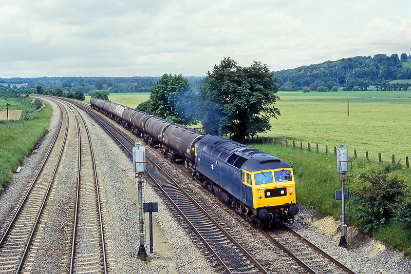 10th Jul 81:   47248 with a rake of bogie oil tanks on the Up Relief at Purley on Thames