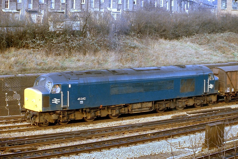 16th Feb 81:  45042 has arrived at the foot of the drop down from the North London Line and is about to enter the yard at Acton Mail Line with a freight train.