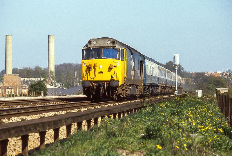16th Apr 1981: 31 minutes after it started from Paddington  50003 'Temeraire' is passing the Power Staion at Early as it slows for the Reading stop  while  working the 15.00 Paddington to Paignton