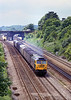 27th May 81:  With Twyford Station in the background 47488 is captured on  the 'Up Main' with a parcels service