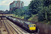 17th Jul 1981:  At 11.35 33065 runs south away from East Croydon station  with a rake of 4 wheek oil tanks