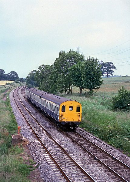 1st Jul 81:  Class 205 Hampshire Unit 1133 forming the 13.53 from Reading to Basingstoke is pictured from the Park Lane bridge in Silchester