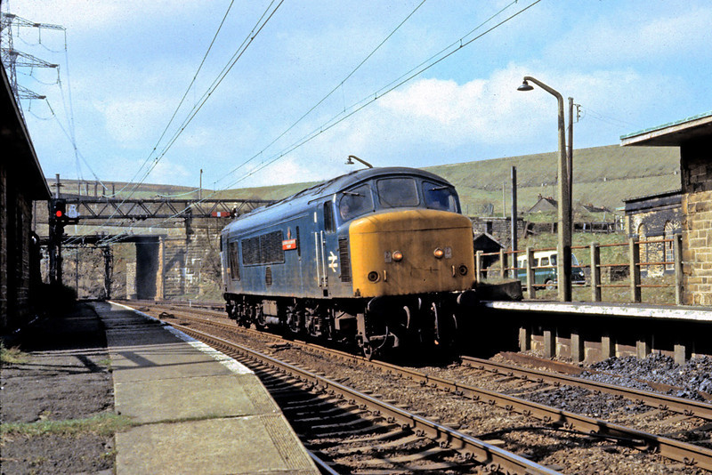 13th Apr '81:  46026 comes out of the Woodhead Tunnel and through the closed Dunford Bridge Station