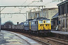 13th Apr 1981:  Drifting down through Penisitone: are 76025 & 76027 with empties for Wath from Guide Bridge