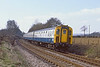 31st Mar 82:  4TC 424 is forming the  13.54 Salisbury to Waterloo on the curve approaching the Battledown Flyover.  Pounding away on the tail was 33114