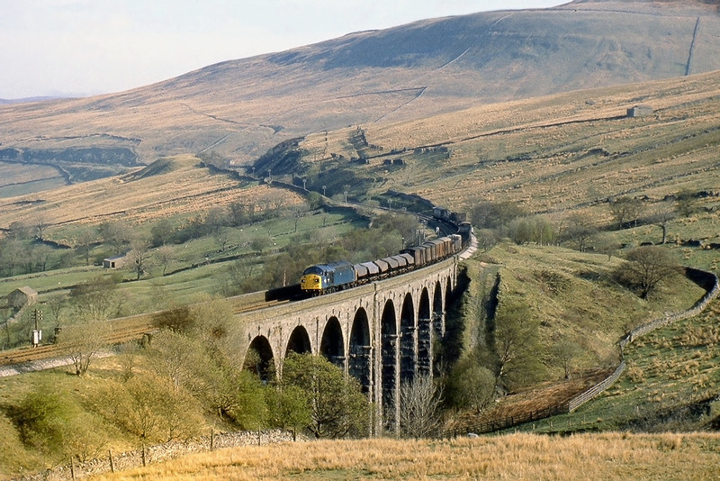 26th Apr 82:  A southbound freight crosses Dent Head Viaduct powered by 40135