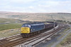 26th Apr 82:  45070 passing the sidings at Garsdale with a long rake of 16 tonners.  Shame that I lost the sun though.